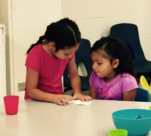 Helping one another is one of the lessons learned in preschool.